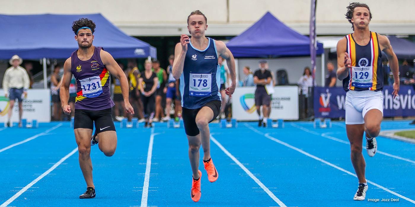 Athlete Kye Mason sprints during a 100m race