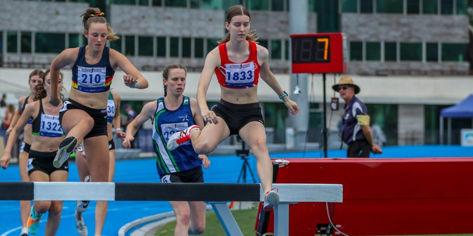 Taryn Furletti hurdles in a steeple chase event