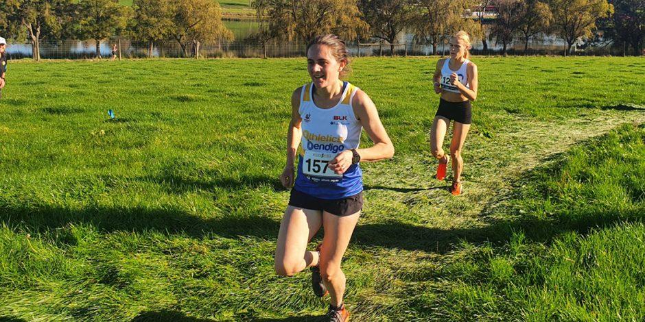 Alice Wilkinson running at the 2021 Athletics Victoria's XCR round at Lardner Park